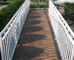 Slate stenciled concrete handicap ramp.