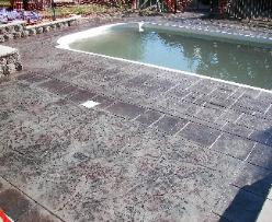 Stamped pool deck with seamless texture inlay.