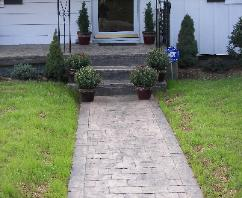Large cobblestone stamped concrete walk.