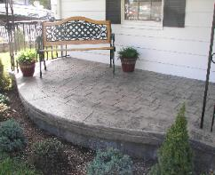 Large cobble stone stamped concrete porch.