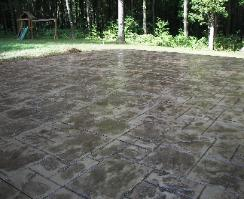 large ashlar slate stamped concrete patio