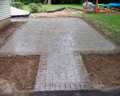 Aslar slate with brick border stamped concrete